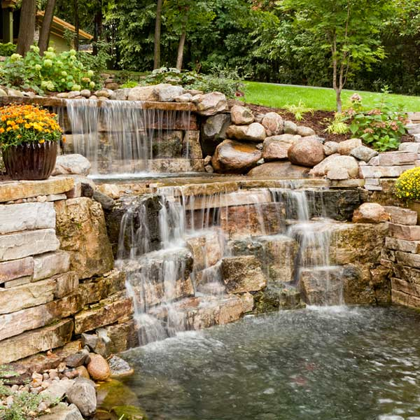 waterfall behind home design by landscape architecture professional