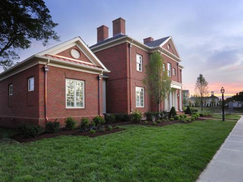 exterior of home with sunset and landscaping by landscape architect