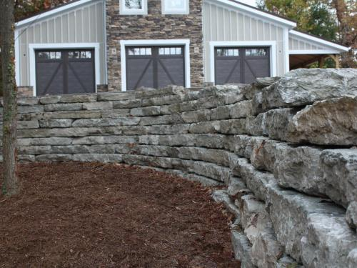 exterior retaining wall with landscape by landscaping companies