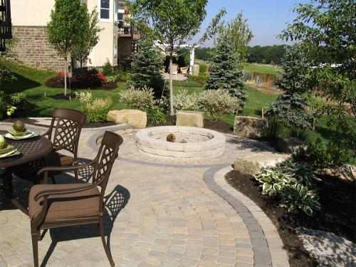 Another gorgeous back yard landscaping job with fire pit