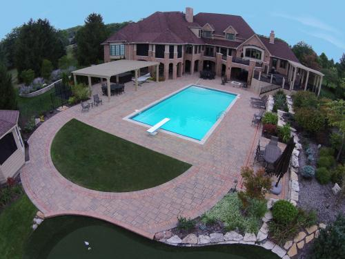 aerial shot of residence with a beautiful green lawn by landscape contractor