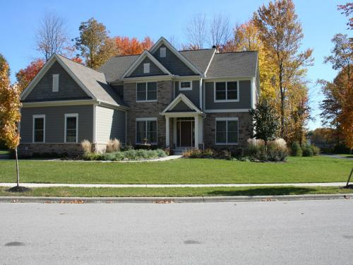 exterior front landscape design with fall color by landscape architect