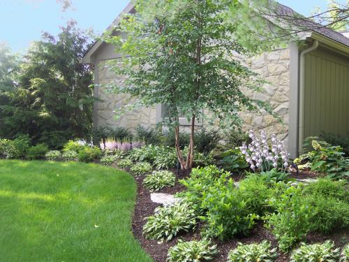 exterior front landscape design with summer color by landscape architect