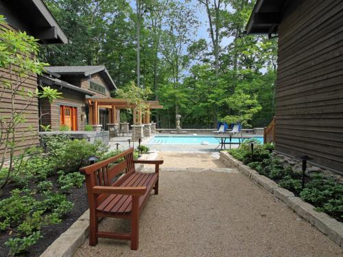 exterior of home with pool and landscaping by landscape architect